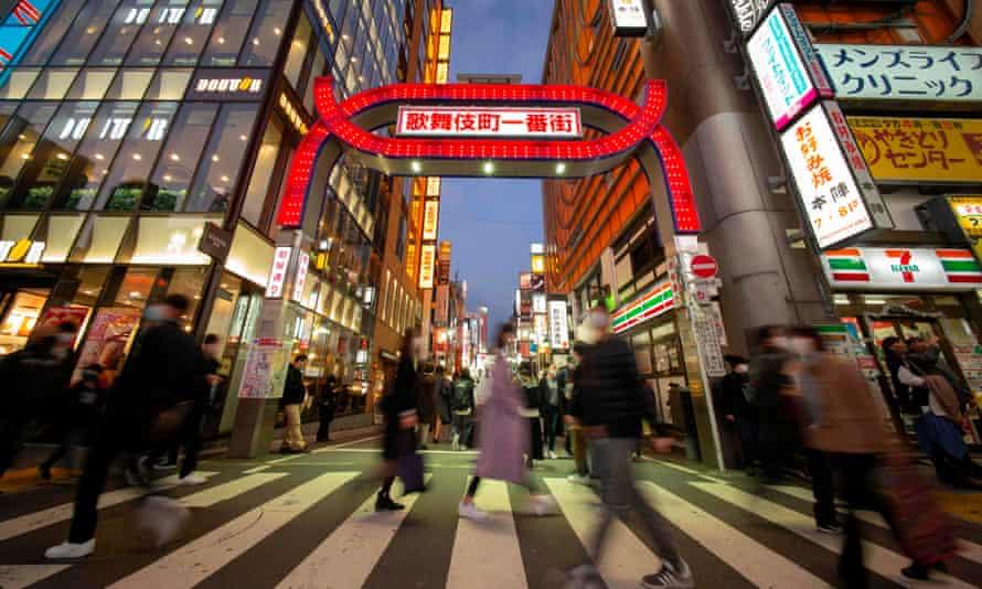 Pedestrians cross a street in Tokyo's Shinjuku area