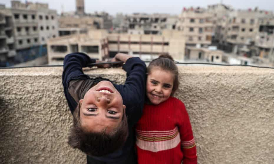 Children from a displaced family living at an abandoned school in Hamoria, al-Ghouta, Syria.
