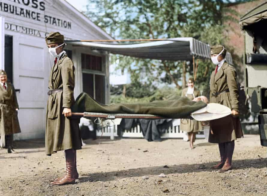 Demonstration (of nurses carrying a patient on a stretcher) at the Red Cross Emergency Ambulance Station during Influenza Pandemic, Washington DC, 1918: black and white image coloured by artist Marina Amaral