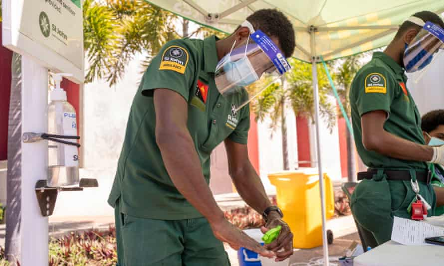 A St John's Ambulance staff member sanitises his hands at the Drive in Covid Testing which has been set up at the Taurama Aquatic Centre in Port Moresby.