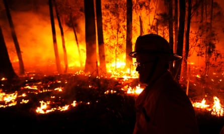 Crews monitor the fires between the towns of Orbost and Lakes Entrance in East Gipplsland, Victoria