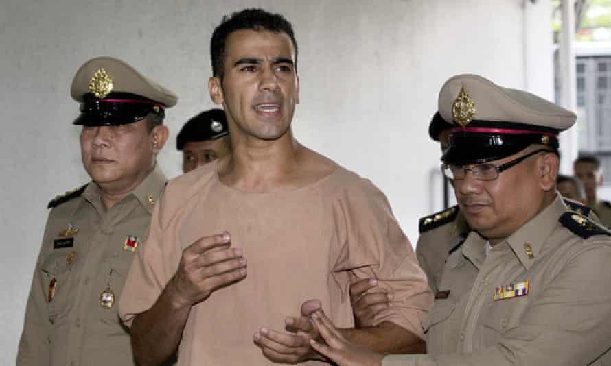 Bahraini football player Hakeem al-Araibi being arrested in Bangkok.