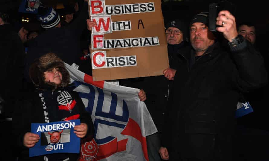 Bolton fans protest against the running of the club by Ken Anderson before January's home game against West Bromwich Albion. Their side will be relegated on Friday if Wigan win.