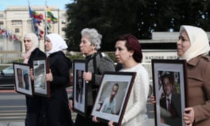 Relatives of detained and disappeared Syrians march silently outside peace talks at the Palais des Nations in Geneva.