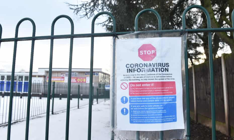 A coronavirus sign displayed outside a primary school in Newcastle-under-Lyme, Staffordshire