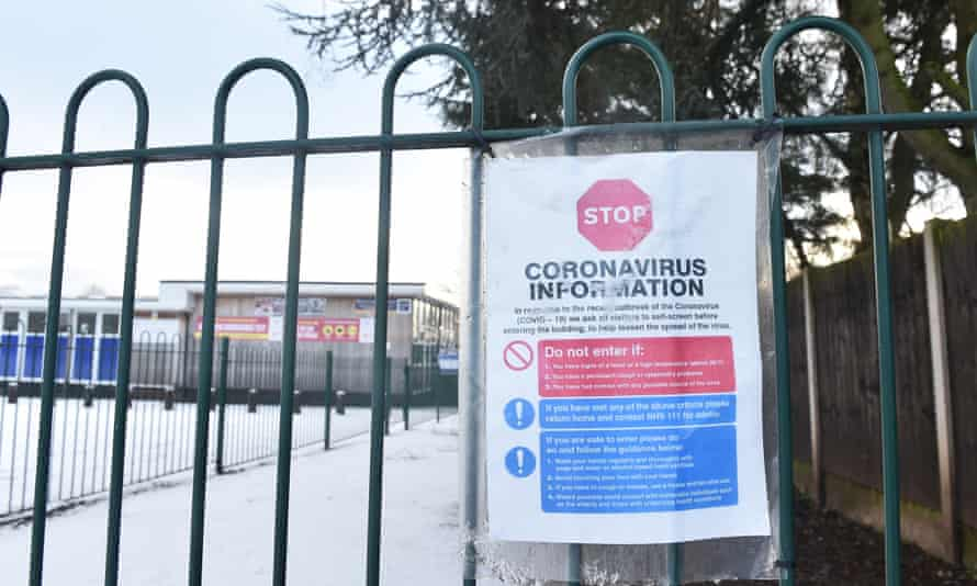 A coronavirus sign is displayed outside a primary school in Newcastle Under Lyme, England.