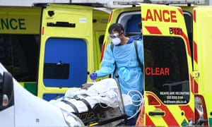 Patient emerges from ambulance on stretcher