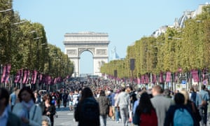Crowds on the Champs Elysees during a car-free day in Paris