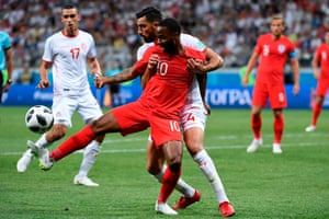 Sterling vies with Tunisia's defender Yassin Meriah.