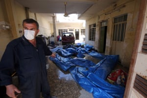 An Iraqi rescue worker tends to victims of the conflict in the Jadida district