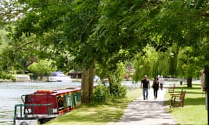 People enjoy the sunshine along the banks of the Thames in Henley, Oxfordshire.