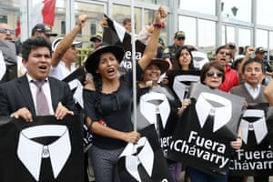 """Lima, PeruPeople hold placards reading """"Chavarry out"""" referring to Peru Attorney General Pedro Chavarry, during a protest outside the Attorney General's Office"""