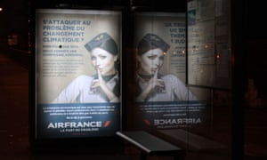 A spoof ad by Revolt Design on the streets of Paris during COP21 conference.