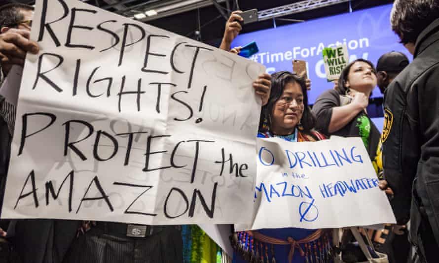 Campaigners protest at the UN climate talks in Madrid.