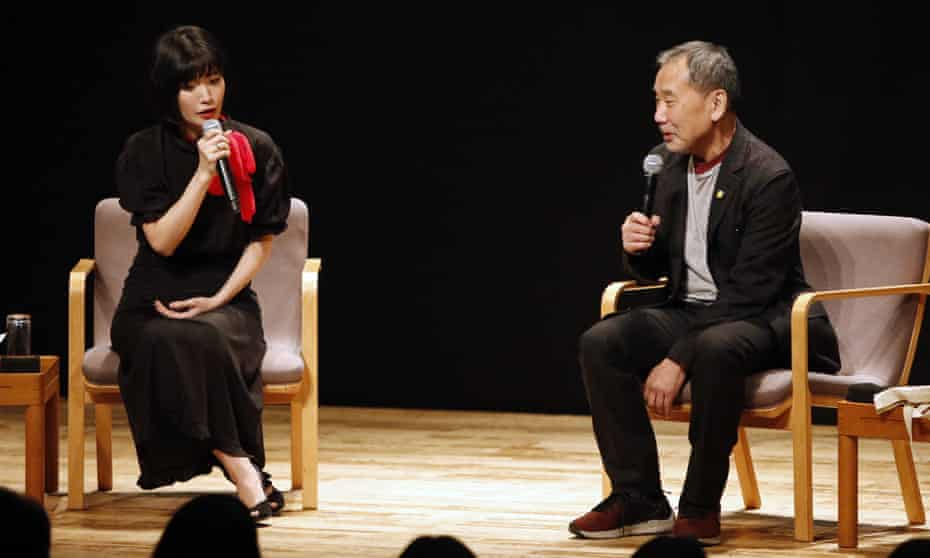 Praise … Kawakami speaks on stage with Haruki Murakami in Tokyo, in 2019.