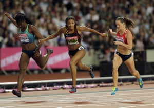 Brazil's Tamara De Sousa, Belgium's Nafissatou Thiam and Czech Republic's Katerina Cachova, from left to right, compete in the women's heptathlon 200m.