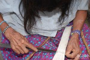 Juama Perez Chispi, Segundo's mother, weaving a cotton bracelet for sale.