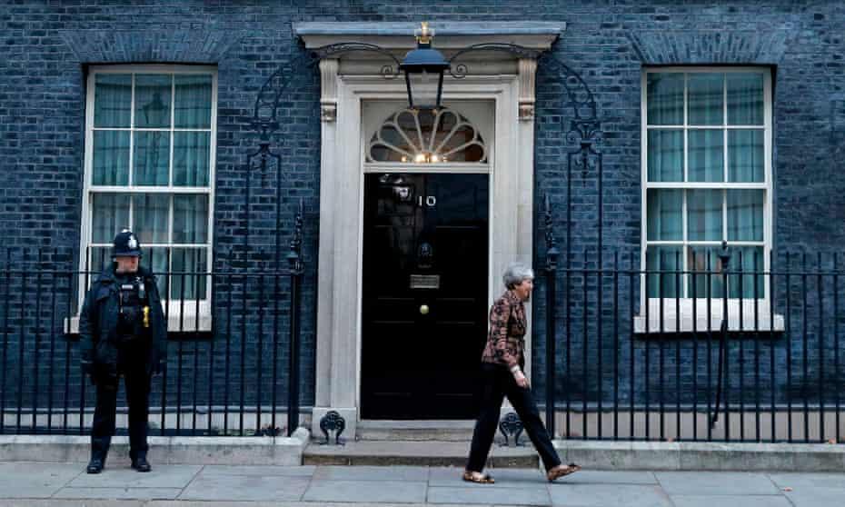 Theresa May walks away from 10 Downing Street.