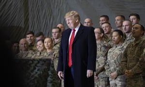 Donald Trump smiles before addressing members of the military during a surprise Thanksgiving Day visit at Bagram Air Field, Afghanistan, in 2019.