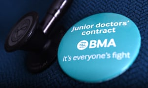 A doctor wearing a BMA campaign badge