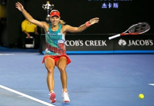 Kerber falls to the ground after winning.