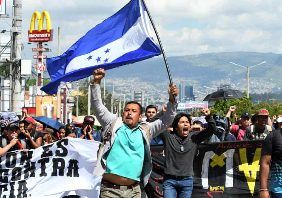 Demonstrators march against government reforms in Tegucigalpa on Tuesday.