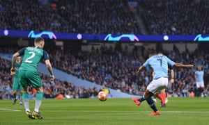 Raheem Sterling of Manchester City scores his team's first goal.