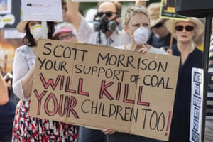 Protesters marched on prime minister Scott Morrison's official residence in Sydney to demand curbs on greenhouse gas emissions and highlight his absence on an overseas holiday as bushfires burned across NSW.