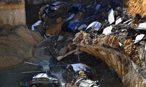 A street in the Balduina district in Rome shows a huge sinkhole that swallowed six cars.