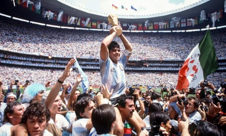 Diego Maradona holds up the World Cup following Argentina's 3-2 victory over West Germany in the 1986 final in Mexico City. The forward was his country's best player and inspiration