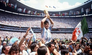 Diego Maradona proudly holds aloft the World Cup trophy in 1986.