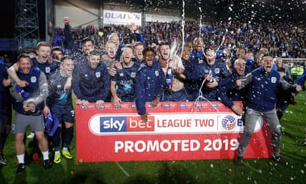 Bury celebrate this season's promotion to League One, achieved against a backdrop of problems.