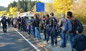 German police guide refugees after they crossed the border from Austria.