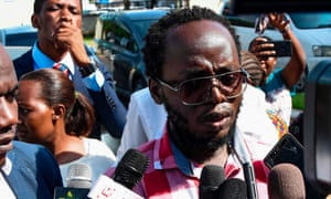 Erick Kabendera speaks to the press following his release on 24 February