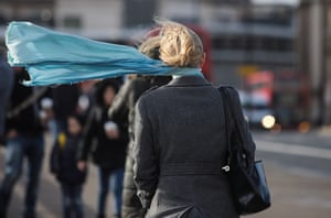 A woman's scarf blows in the wind on London Bridge