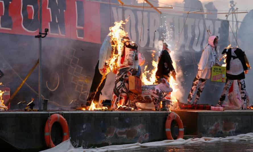 Dummies of David Cameron, Theresa May and George Osborne were burned by Joe Corré alongside punk memorabilia on Saturday.