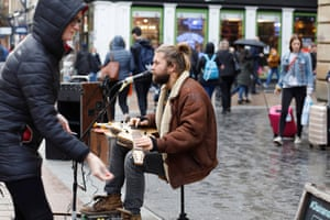 Malachy, who is from Australia, busking in Glasgow.