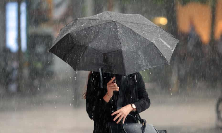 Woman With Umbrella In Heavy Rain