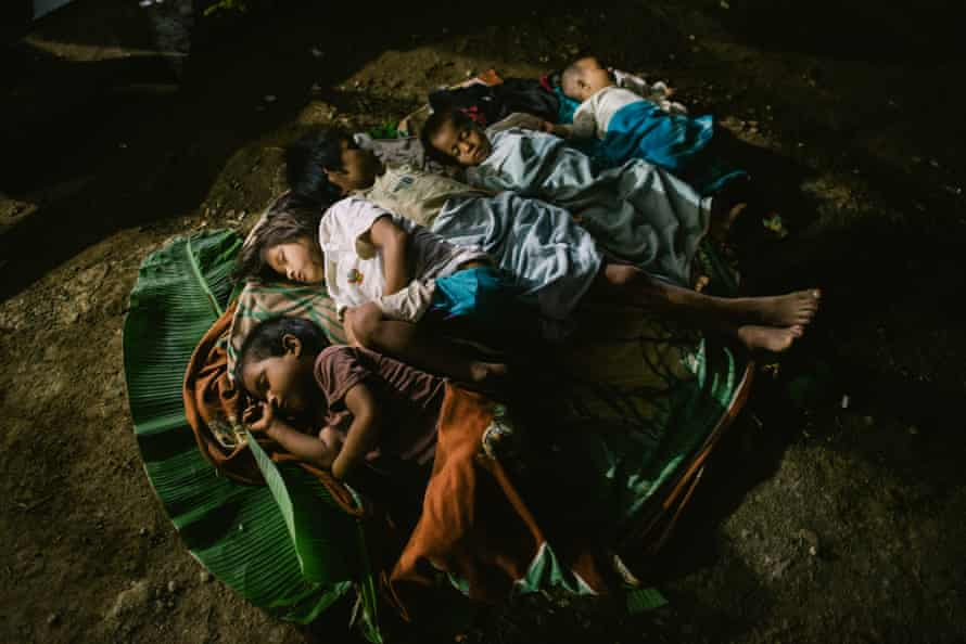Children sleep during the farewell party of the assembly of the Wampis nation