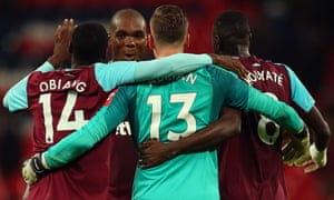Angelo Ogbonna of West Ham United celebrates with his team mates after the Carabao Cup Fourth Round match.