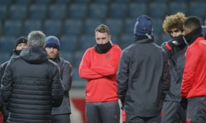 Manchester United players wrap up warm to listen to José Mourinho, second left, during a training session before their final Europa League tie against Zorya.