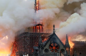 Smoke billows as fire engulfs the spire of Notre Dame Cathedral in Paris