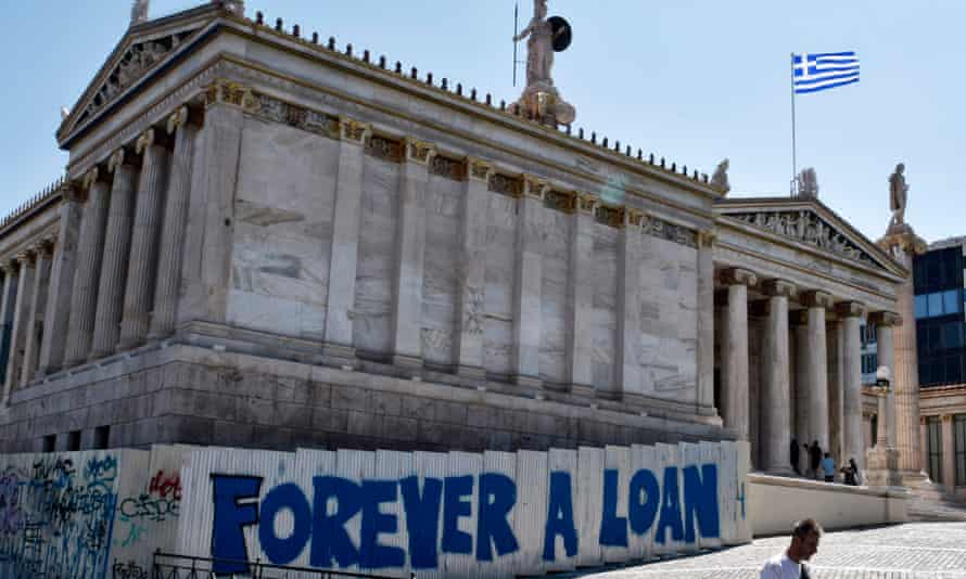 Graffiti referring to Greek debt outside the Academy of Athens