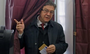 Mélenchon leaves a polling booth.