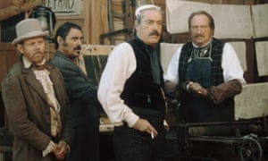 Powers Boothe, second right, standing next to Ian McShane, second left, in Deadwood, 2004.