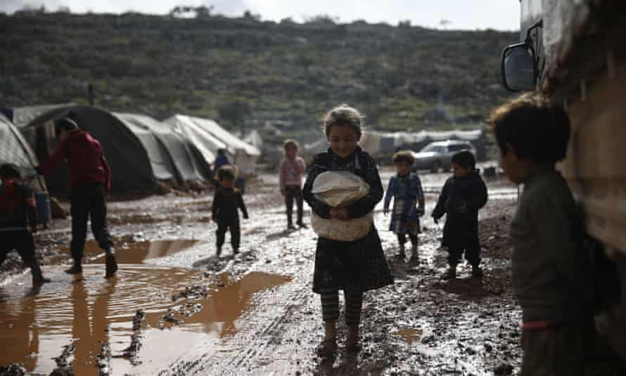 Refugees in a camp in Idlib, Syria, some of the 24 million people in the country now relying on aid to survive.
