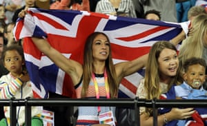 Mo Farah's wife Tania watches from the stands.