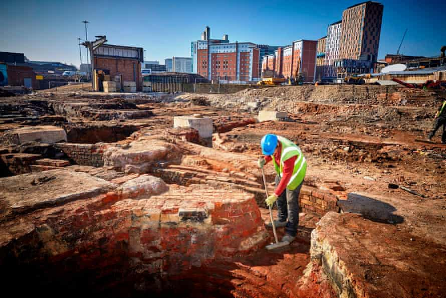 Richard Carter from Salford Archaeology works on the newly discovered foundations of a chimney at Mayfield Park.