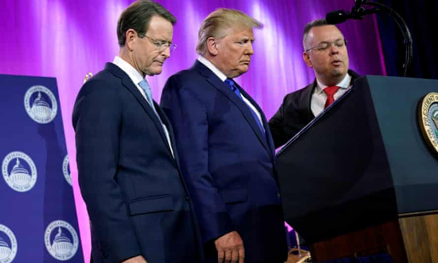 Donald Trump prays between Tony Perkins, the president of the Family Research Council, and Pastor Andrew Brunson.