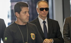 Carlos Arthur Nuzman, right, the president of the Brazilian Olympic Committee and honorary member of the IOC, arrives at the headquarters of the Federal Police to give a statement in Rio.